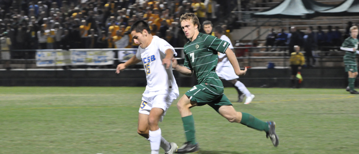 IMAGE: A Cal Poly and a UC Santa Barbara soccer player fight over the ball.